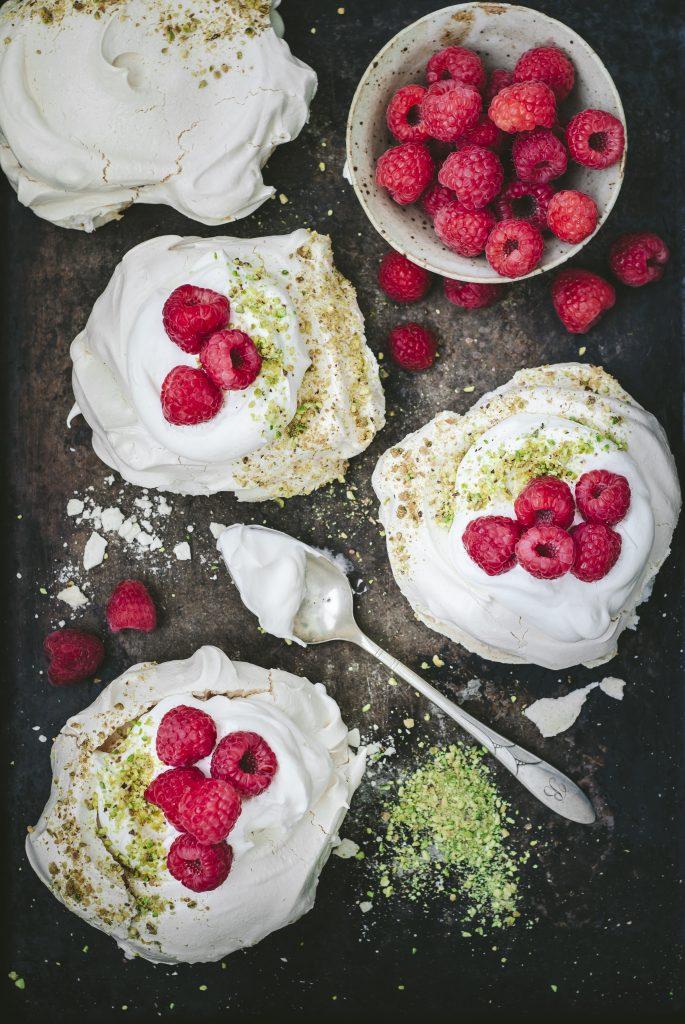 raspberry pistachio pavlovas | kumquatblog.com @kumquatblog